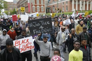 Protesters are gathered for a rally to protest the death of Freddie Gray who died following an arrest in Baltimore